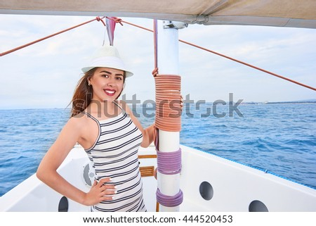 Portrait of Beautiful smiling woman on a yacht, summertime concept - stock photo