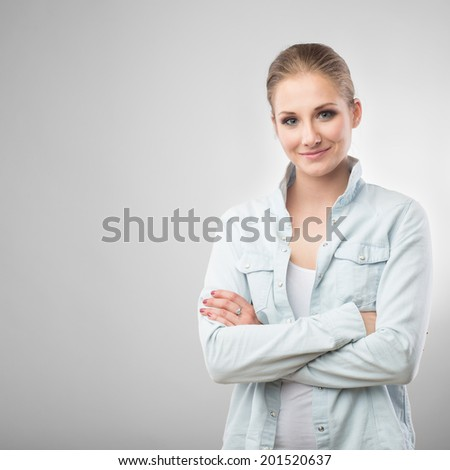 portrait of beautiful smiling woman on white background - stock photo