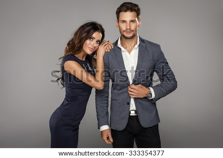 Portrait of beautiful smiling woman with handsome man - stock photo