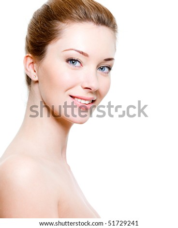Portrait of beautiful smiling woman with healthy skin - stock photo