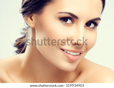 portrait of beautiful smiling young woman with naked shoulders - stock photo