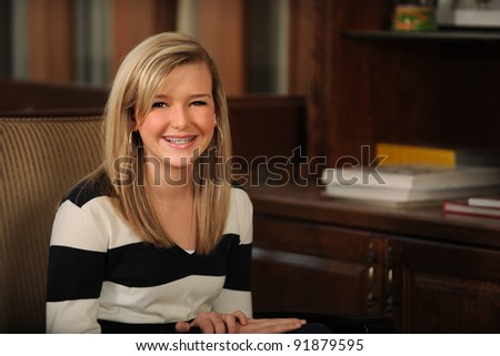 Portrait of beautiful teen girl with braces smiling inside home - stock photo