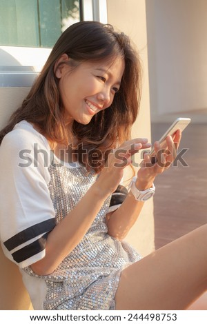portrait of beautiful teen woman chat social media on smart phone with happiness face use for people and modern hi-technology to connecting ,chat, on line talking on wireless media - stock photo
