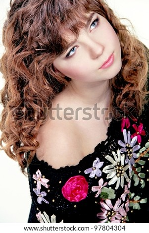 Portrait of  beautiful teenager girl with long curly hairs - isolated on white - stock photo