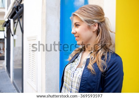 Portrait of beautiful teenager tourist girl in picturesque street in destination city carrying shopping bags, smiling outdoors. Adolescent woman consumer lifestyle in fashion stores. - stock photo