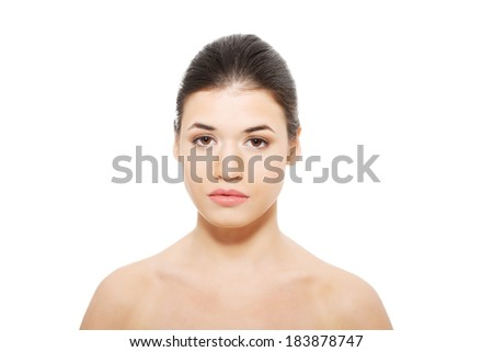 Portrait of beautiful topless woman touching her face. Isolated on white. - stock photo