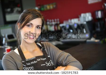 Portrait of beautiful waitress in coffee shop - stock photo