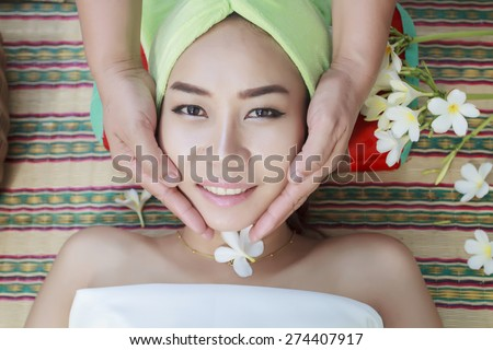 portrait of beautiful woman asia in spa environment and Beautiful woman with facial mask at beauty salon - stock photo
