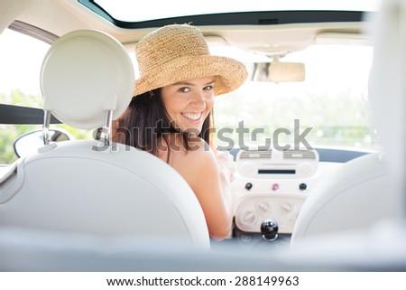 Portrait of beautiful woman driving car - stock photo