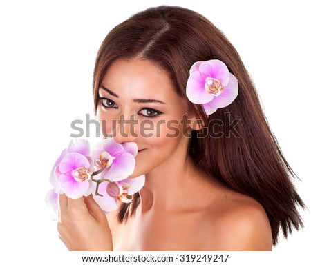 Portrait of beautiful woman enjoying nice sweet smell of pink fresh orchid flower isolated on white background, luxury spa salon - stock photo