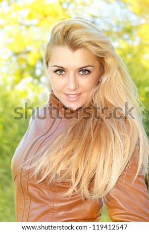 Portrait of beautiful woman, Fall environment. - stock photo