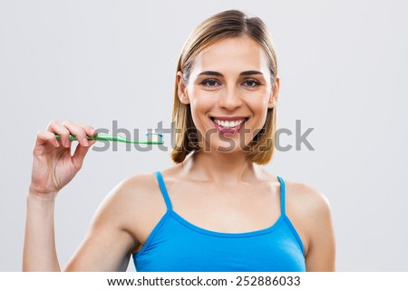 Portrait of beautiful woman holding toothbrush.Dental hygiene - stock photo