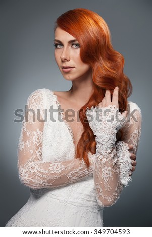 portrait of beautiful woman in wedding dress isolated over white background - stock photo