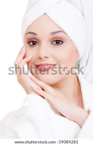 portrait of beautiful woman in white towel on her head - stock photo