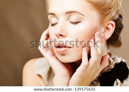 Portrait of beautiful woman isolated on beige - stock photo