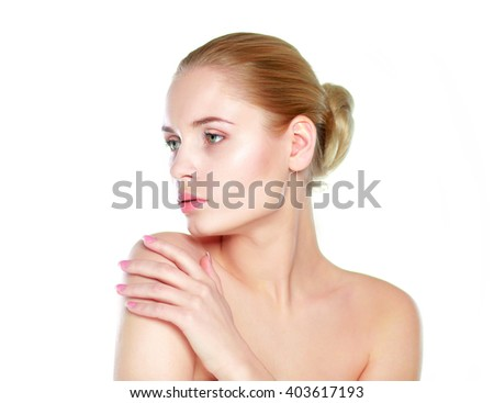 Portrait of beautiful woman isolated on gray background - stock photo