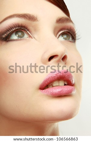 Portrait of beautiful woman, isolated on white background , looking up - stock photo