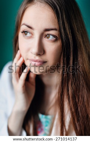 Portrait of beautiful woman looking through a window. - stock photo
