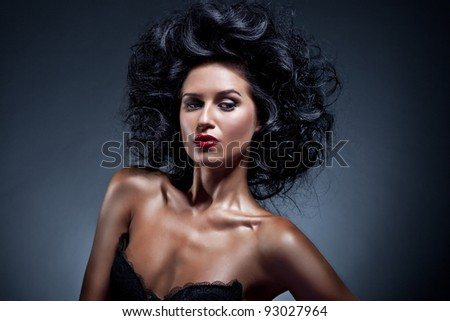 Portrait of beautiful woman on dark blue background - stock photo