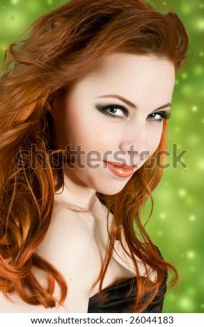 Portrait of beautiful woman on green lighting background - stock photo