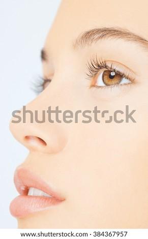 Portrait of beautiful woman on white - stock photo