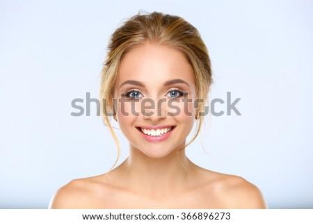 Portrait of beautiful woman on white background - stock photo