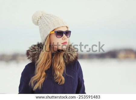 Portrait of beautiful woman outdoors in winter day - stock photo