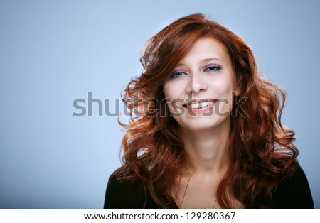 portrait of beautiful woman redhair on gray - stock photo