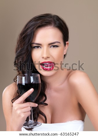 Portrait of beautiful woman, she holding glass of red wine - stock photo