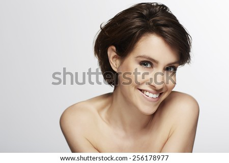 Portrait of beautiful woman smiling - stock photo
