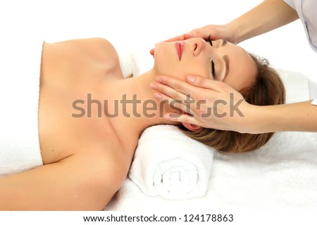 Portrait of beautiful woman taking head massage - stock photo
