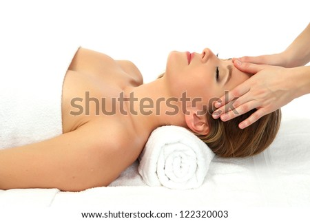 Portrait of beautiful woman taking head massage, isolated on white - stock photo