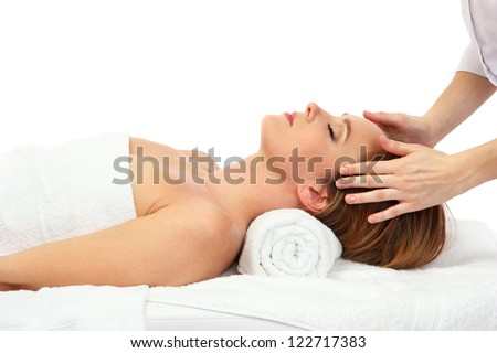 Portrait of beautiful woman taking head massage, isolated on white - stock photo