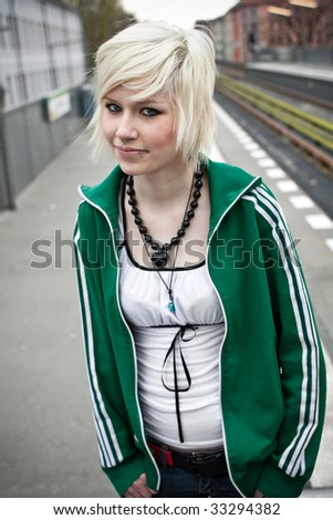 portrait of beautiful woman waiting for the train - stock photo