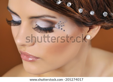 Portrait of Beautiful Woman Wedding Model. Advertising and Commercial Design. Shopping. Jewelry - Bridal Earrings, Hairstyle. - stock photo