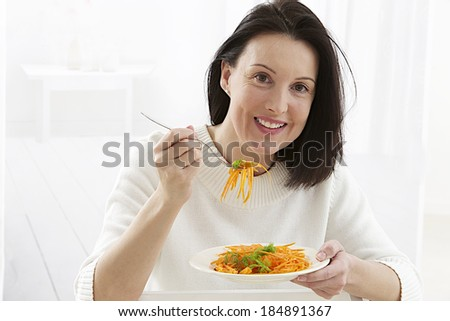 Portrait of beautiful woman with a fresh carrot salad  - stock photo