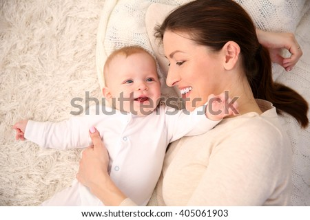 Portrait of beautiful woman with baby, close up - stock photo