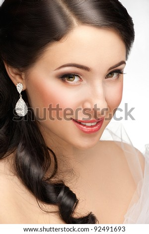 Portrait of beautiful woman with beautiful make-up and hairstyle. Elegant woman with diamond earring - stock photo
