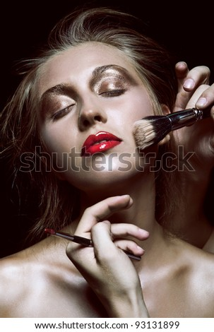 Portrait of beautiful woman with beautiful make up on black background - stock photo