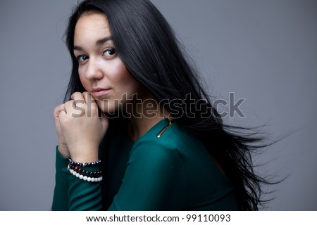 portrait of beautiful woman with black long hairs - stock photo