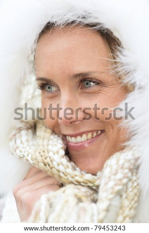 portrait of beautiful woman with blue eyes in autumn - stock photo