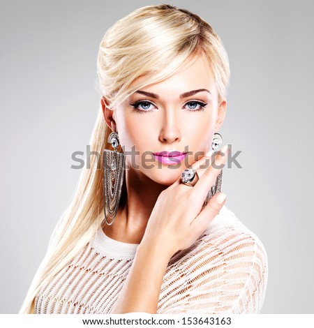 Portrait of beautiful woman with bright fashion makeup and long white hairs. - stock photo