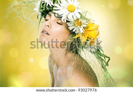 Portrait of beautiful woman with chaplet of flowers on yellow background - stock photo
