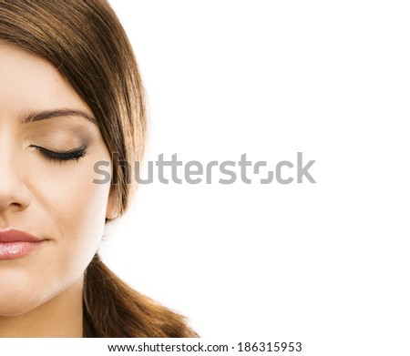 Portrait of beautiful woman with closed eyes on white background - stock photo