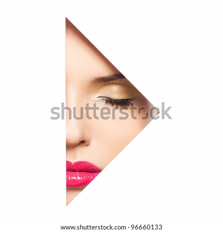 Portrait of beautiful woman with closed eyes through paper triangle - stock photo