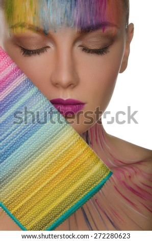 Portrait of beautiful woman with colorful purse and face art isolated on white - stock photo