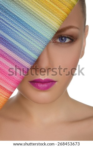 Portrait of beautiful woman with colorful purse isolated on white - stock photo