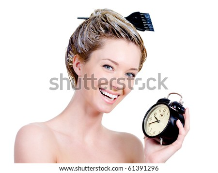 Portrait of beautiful woman with dye on a hair and holding clock - isolated on white - stock photo