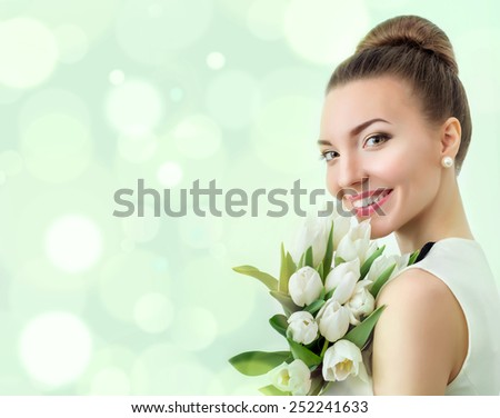Portrait of beautiful woman with flowers. Professional make up. Place for text, copyspace. Bokeh. - stock photo