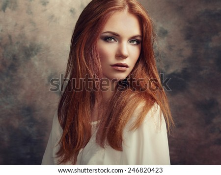 Portrait of beautiful woman with fresh makeup and romantic  hairstyle. Fashion photo - stock photo